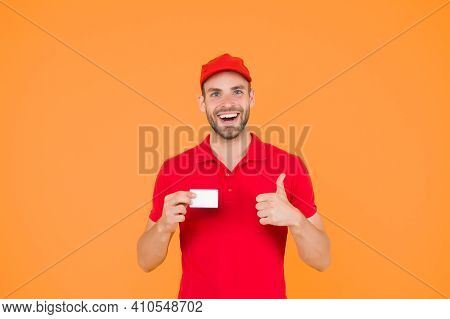 Pizza Delivery Man Hold Business Card. Man Pays The Deliverer. Pay With Bank Card. Methods Of Paymen
