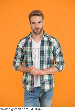 Stylish Male In Trendy Clothing. Handsome Man In Checkered Shirt And Jeans. Charismatic Student Yell