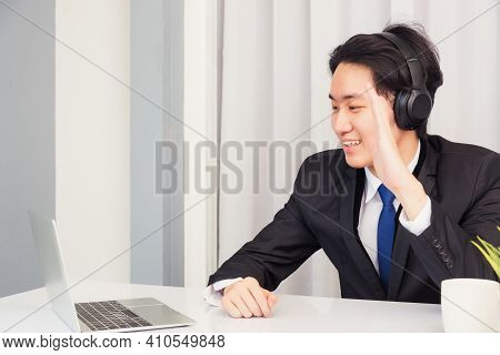 Work From Home, Asian Young Businessman Smile Wearing Headphones And Suit Video Conference Call Or F