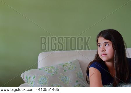 Ten Year Old Girl Looking At The Horizon From The Sofa