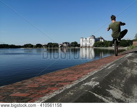 Russia, Kaliningrad - August 15, 2020. View Of The Upper Lake And A Biker