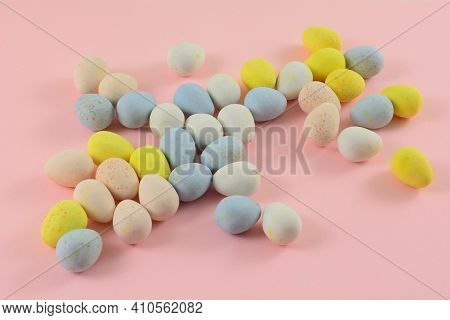 Pastel Colored Candy Easter Eggs In White Dessert Bowl On Pink Background