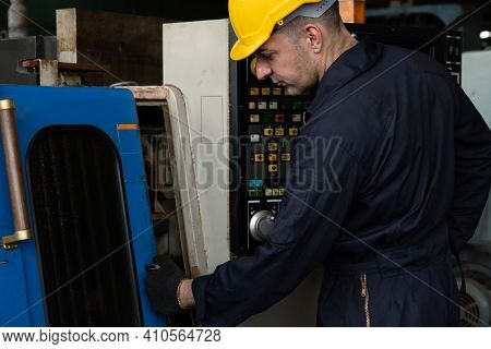 Skillful Factory Engineer Or Worker Do Machine Job In Manufacturing Workshop . Industrial People And