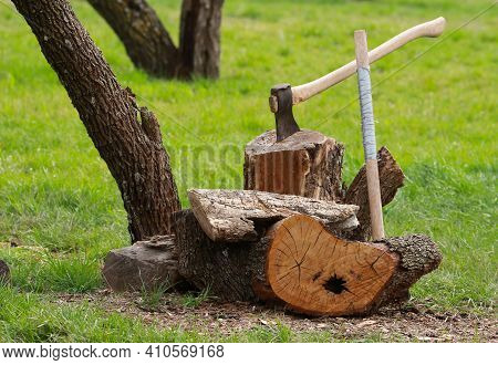 A Country Landscape Of Farm Life Featuring Chopped Wood And An Ax