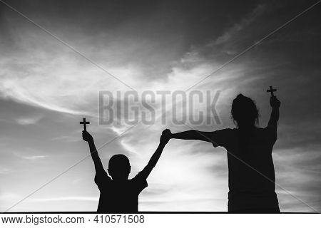 Two Children Worship God By Holding Christian Cross, Christian Concept.