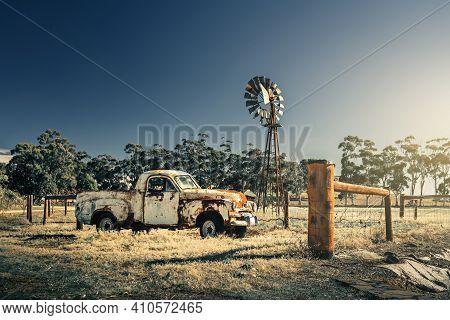 Kapunda, South Australia - June 17, 2017: Abandoned Rusty Classic Holden Fj Ute Parked Nex To An Old