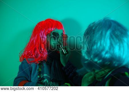 Two Beautiful Kids Play Cosmetics, Paint Lips With Lipstick Getting Ready For The Nightclub. Disco L