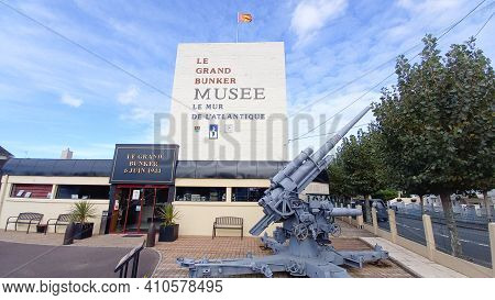 Ouistreham , Normandy France - 02 20 2021 : The Grand Bunker Text Sign On Facade Building Of Former