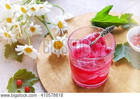Summer Dessert, Fruit Ice Or Frozen Sorbet Or Granite From Red Currant Puree And Sugar Syrup In A Gl