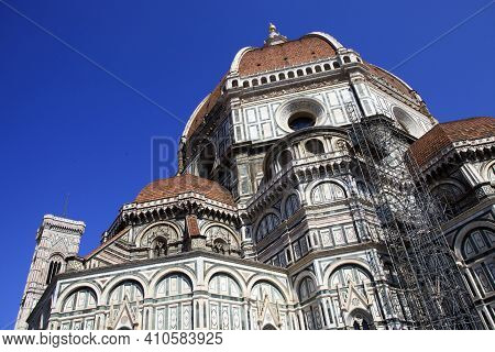 Firenze, Italy - April 21, 2017: The Duomo With Giotto Bell Tower And Brunelleschi Cupola In Florenc