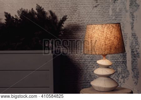 Modern Lamp Interior In Living Room On A Table. Selective Focus. Shallow Depth Of Field