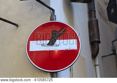 Firenze, Italy - April 21, 2017: Road Sign Defaced By Street Artist Clet Abraham, Florence, Firenze,
