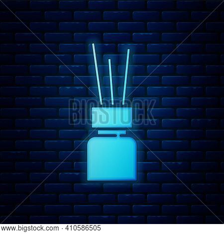 Glowing Neon Aroma Diffuser Icon Isolated On Brick Wall Background. Glass Jar Different With Wooden