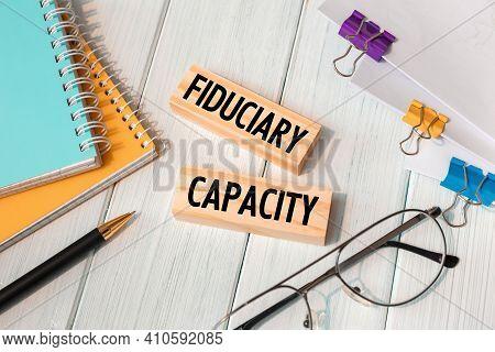 Fiduciary Capacity - Words Written On Wooden Blocks Near Office Supplies