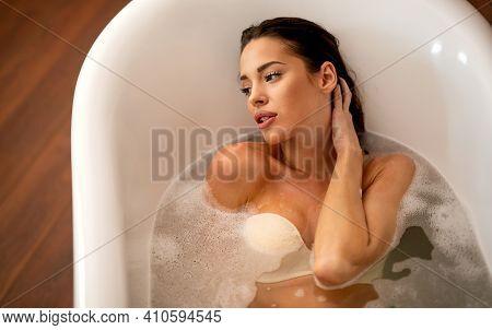 Beautiful Young Sensual Woman Enjoying Pleasant Bath With Foam
