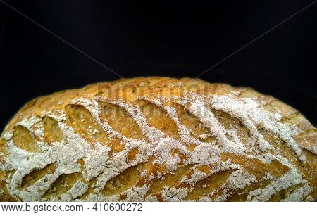Delicious Fresh Baked Bread With Sesame Seeds On Black Background. Natural Bakery Products. Bread Ma