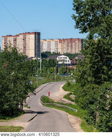 Asphalt Road Leading To Private And A Multi-storey Buildings In Outskirts Of Moscow
