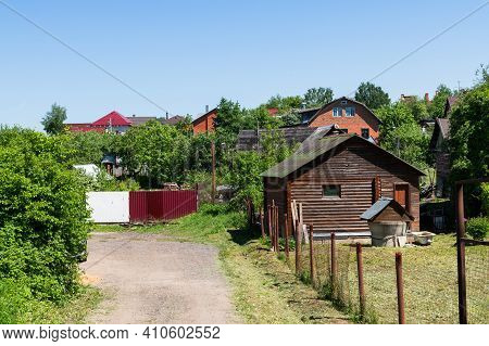 Fragment Of Village With Brick And Wooden Houses. Russia