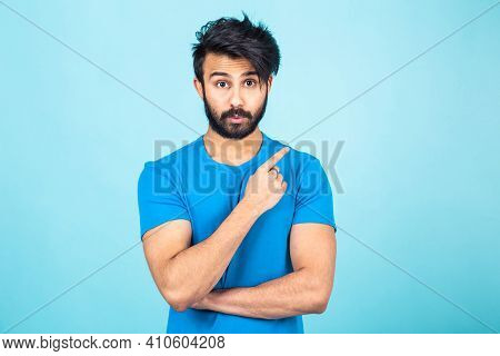 Emotional Portrait Of A Handsome Hindu Man In A Blue T-shirt On A Bright Blue Background, Points Fin