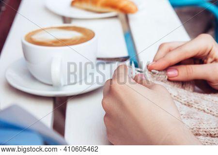 Woman Knitting Outside The House. Handicraft Earnings Concept. Knitting On Light Background. Female
