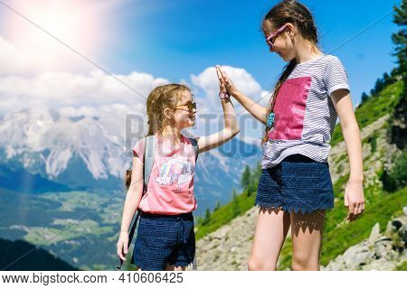 Children Hiking On Beautiful Summer Day In Alps Mountains Austria, Resting On Rock And Admire Amazin