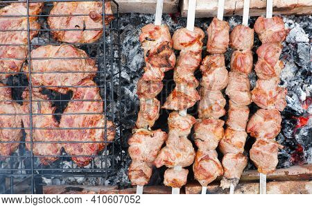 Delicious Grilled Pork Meat In Bbq Barbecue With Pork Meat. Kebabs On The Grill. Close-up Of Meat On