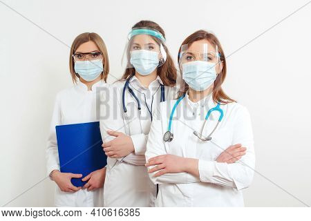 Medical Staff Wearing Face Shield And Medical Mask For Protect Coronavirus. Medicine, Vaccination An