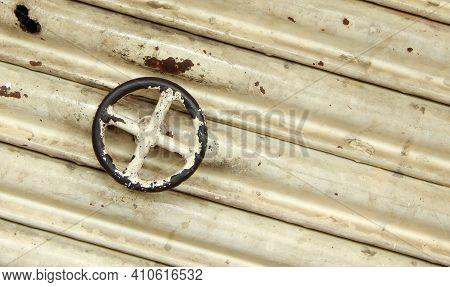 Close-up View Of Circular Handle Of Metal Roller Shutter Door