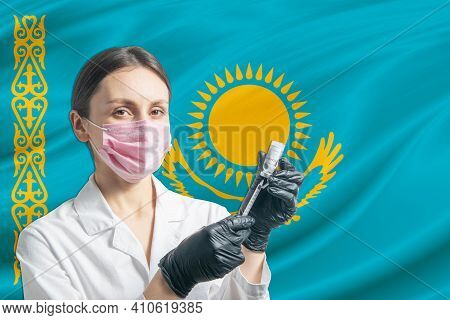 Girl Doctor Prepares Vaccination Against The Background Of The Kazakhstan Flag. Vaccination Concept