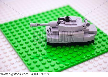 Tambov, Russian Federation - February 26, 2021 Lego Custom Made Tank On Lego Baseplates Background.