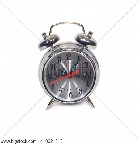 Table Alarm Clock In Silver Stainless Steel Case With A Round Shape Of The Dial, Showing Five Minute
