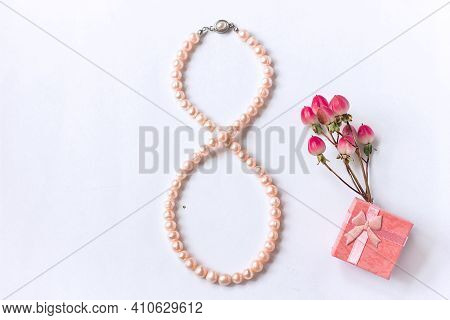 Pearl Necklace In The Form Of Number 8 Gift Box And A Bouquet Of Flowers On A White Background, Wome