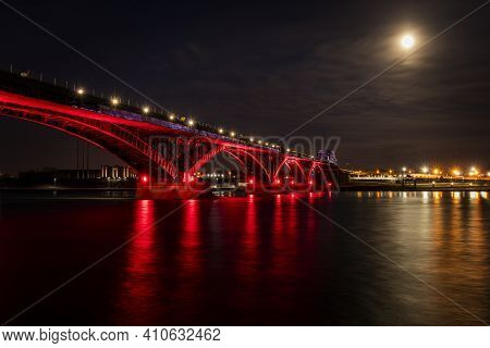 Peace Bridge Near Buffalo Ny State At A Full Moon Night, Illuminated In Red Colours