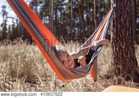 Cute Girl Having Rest In Hammock In The Wild Forest During Local Vacation, Family Summer Weekend, So