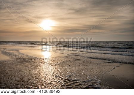 Sunset On A Sunny Winter Day On The North Sea Coast On The Wadden Island Of Texel, The Netherlands