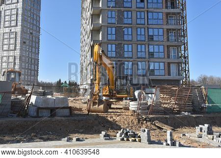 Excavator On Earthworks At A Construction Site During The Construction Of A Residential Multi-storey