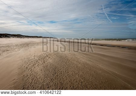 The North Sea Beach On A Sunny Stormy Winter Day With Drifting Beach Sand Near The Slufter Valley On