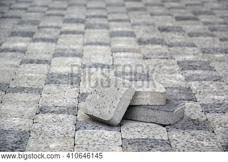 Small Pile Of Gray Walkway Slabs Lying In Stack Outdoors. Material For Paving Slabs By Mosaic In Pro