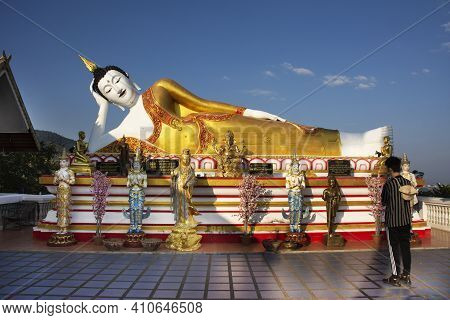 Beautiful Reclining Buddha Image Statue Of Wat Phra That Doi Kham Temple For Thai People And Foreign