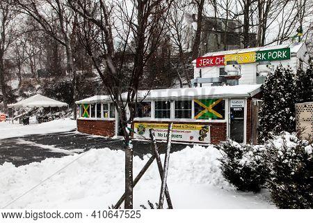 NORWALK, CT, USA-FEBRUARY 1, 2021:  Jerk chicken, Jerk Pork Small Jamaican deli during blizzard  on Connecticut Ave.