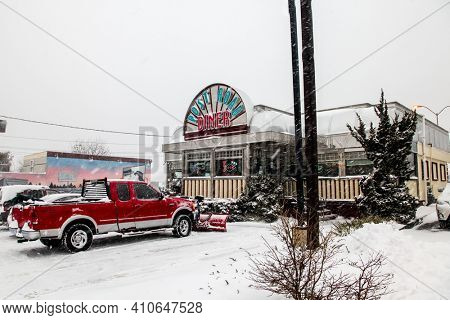 NORWALK, CT, USA-FEBRUARY 1, 2021:  Popular Post Road Diner restaurant during blizzard  on Connecticut Ave.