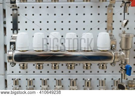 Plumbing Equipment On A Stand In A Store. Collector Group Close-up. Selective Focus