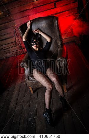 Sexy Woman In Black Underwear In Bdsm Bunny Leather Mask And Accessories. Posing On A Dark Backgroun