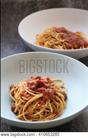 Two Deep Plates With Hot Pasta, Spaghetti Pasta With Meat And Tomato Sauce, Spaghetti Ragus, Meat Bo