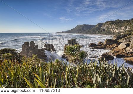 The Incoming Tide Pounding On The Rocky Shoreline At Punakaiki, In The Paparoa National Park On The