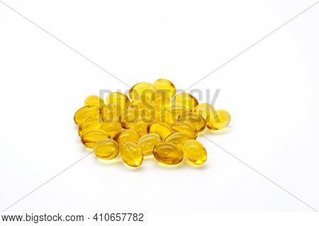 Close Up Vitamin D3 Gel Capsules On White Background.