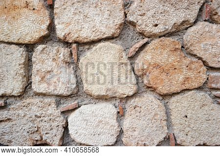 Ancient Stone Wall Surface Texture. The Surface Of An Ancient Wall Made Of Big Stones.