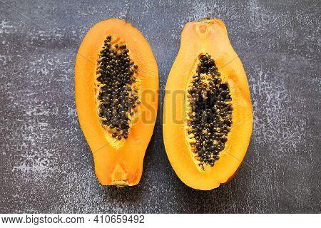 Halved Papaya, Orange Fruit With Tiny Seeds Inside, Juicy Papaya With Seeds, Small Seeds, Fruit Full