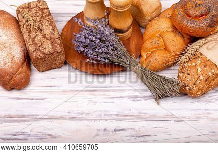 Rural Breakfast With Fresh Bread. Fresh Homemade Italian Bread. Composition With Tasty Lavender Baki