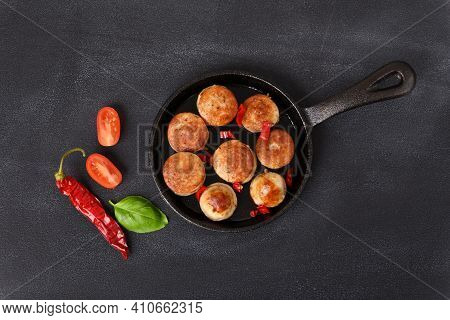 Cut Roasted Sausages With Red Pepper In A Pan. Top View.